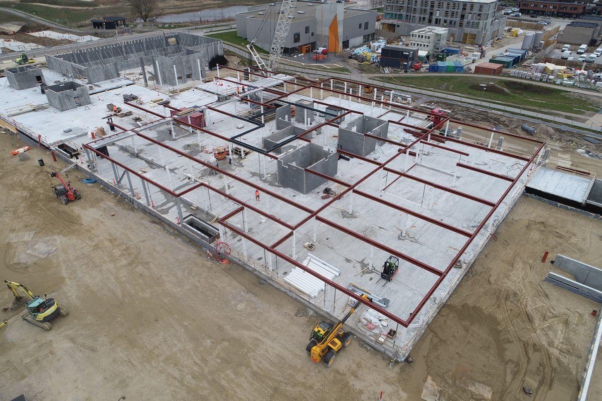 Integrerede stålkompositbjælker skaber slanke etagedæk