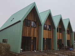 Smuk arkitektur med facade- og tagbeklædning fra Areco Profiles