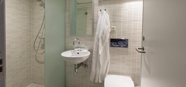 Hoteller sparer stort og styrker bæredygtig profil med vandbesparende teknologi